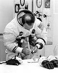 Ed Mitchell adjusts his watch Ap14-KSC-71P-88.jpg