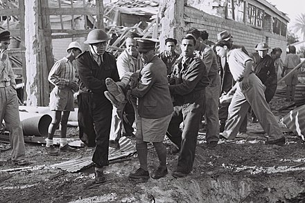 Volunteers evacuating a wounded man during Egyptian bombardment of Tel Aviv. Egyptian bombing 1948.jpg