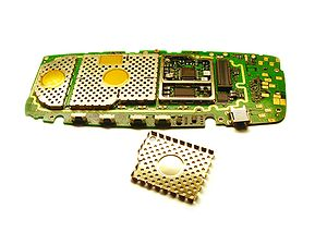 Electromagnetic shielding - Electromagnetic shielding cages inside a disassembled mobile phone.