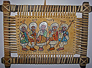 This leather painting depicts Ethiopian Orthodox priests playing sistra and a drum.