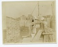 Exterior marble work - men putting a stone in place (NYPL b11524053-489470).tiff