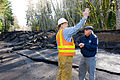 FEMA - 40124 - FEMA PIO and WA DOT official at a broken roadway in Washington.jpg