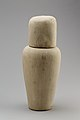 Falcon-headed stopper (Qebehsenuef) from a canopic jar MET 28.3.116a b EGDP019910.jpg