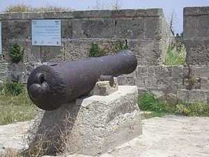 Haim Farhi - 19th-century cannon, set in the wall of Acre near a sign commemorating Farhi. The Hebrew inscription on the sign reads: Farhi vs. Napoleon. Jezzar's right hand in resisting Napoleon's harsh siege was the Jewish Haim Farhi, senior adviser and minister of finance