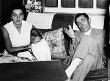 Fausto Coppi and Giulia Occhini sitting on a sofa