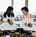 First lady Kim Yoon-ok, right, serves kimchi to Miyuki Hatoyama, wife of Japan's Prime Minister Yukio Hatoyama, while making kimchi together (4347069489).jpg