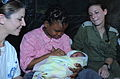Flickr - Israel Defense Forces - First Baby Delivered at IDF Field Hospital in Haiti, Jan 2010.jpg