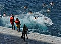 Flickr - Official U.S. Navy Imagery - Sailors and Marines participate in a swim call..jpg