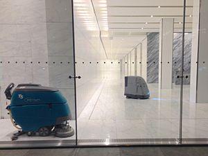 Floor scrubber - T5 walk-behind floor scrubber by Tennant (left) and HydroBot floor-scrubbing robot by Intellibot Robotics (right).