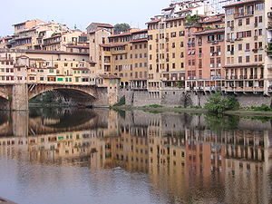 Buildings reflected in river. Florence, Italy