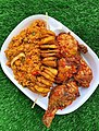 Fried rice, plantain and peppered chicken.jpg