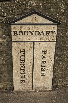 Sign marking boundary between parish and turnpike trust responsibility, Frome, Somerset