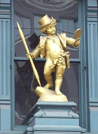 Lafayette Street - Gilded statue of Puck over the front door of the Puck Building