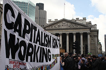 "A banner reading ""Capitalism isn't workin..."