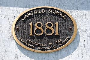 Garfield School (Brunswick, New York) - Plaque commemorating opening, from the Brunswick Historical Society