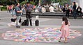 Girl inspects a chalk mandala in Washington Square Park (00936).jpg