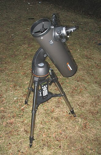 GoTo (telescopes) - A telescope on an alt-azimuth GoTo mount.  Note the keypad, resting on the platform between the tripod's legs, that is the telescope's hand control. Batteries are stored in the circular compartment just above the tripod. In this picture, the compartment is just above the hand control.