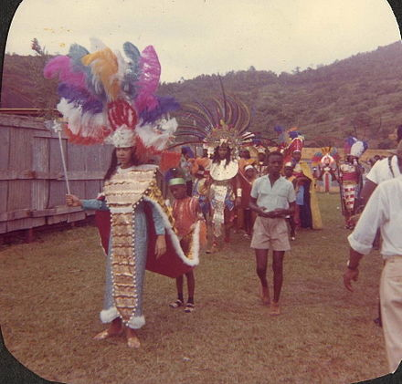 A carnival in 1965 GrenadaCarnival1965FeatheredHeaddresses.jpg