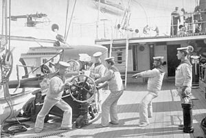 Calypso-class corvette - A closer view of the waist; sailors are training a 5-inch (127.0 mm) breechloader on a Vavasseur mounting; behind it is a 6-inch (152.4 mm) breechloader in a sponson