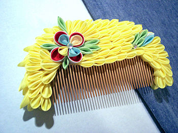 English: Amateur tsumami kushi, a comb, a trad...