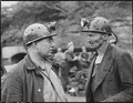 Harry Fain, coal loader, right, talks to his section foreman upon completion of morning shift. Inland Steel Company... - NARA - 541448.tif