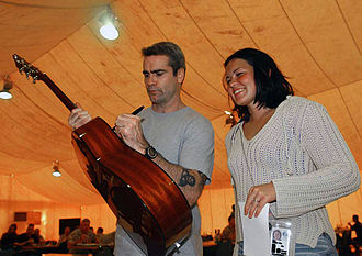 Henry Rollins - Rollins signing a guitar while on a United Service Organizations (USO) tour in Iraq in 2003