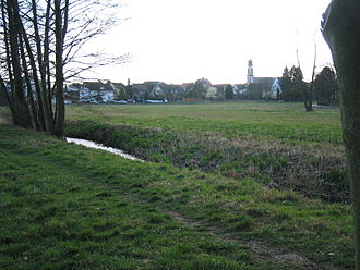 Heusenstamm - View of Heusenstamm with the river Bieber in the foreground