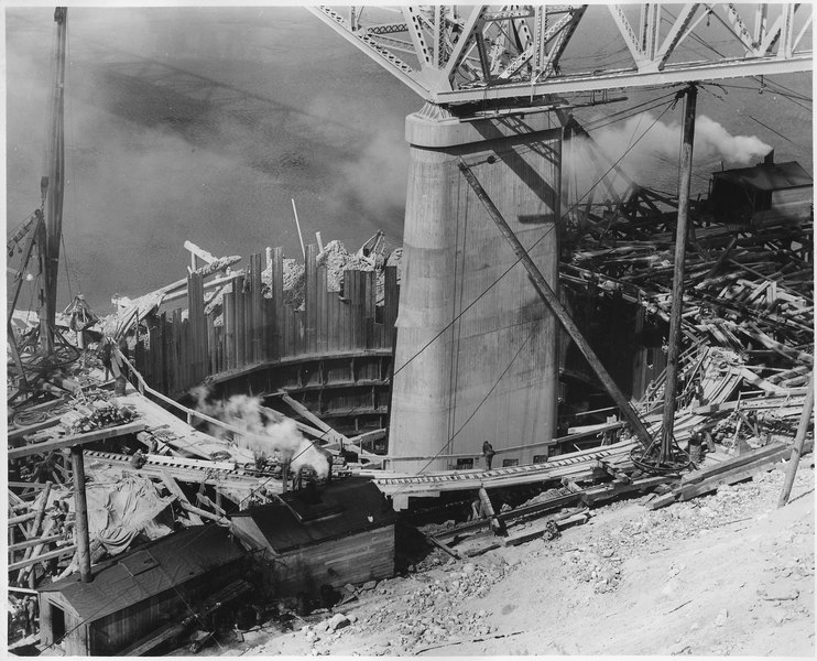 File:Highway bridge pier no. 2 showing sheet pile caisson constructed for pier enlargement - NARA - 294288.tiff