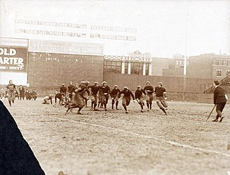 Green Monster - The center-field end of the wall (and Duffy's Cliff) in 1916, during a college football game at Fenway