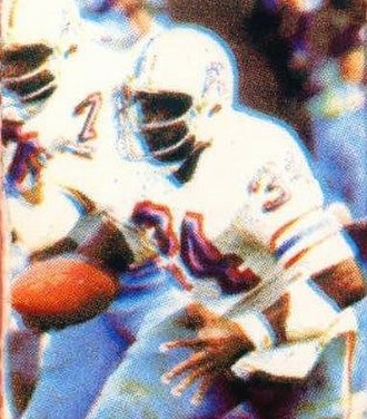 Earl Campbell - Campbell pictured rushing the ball early in his career with the Oilers