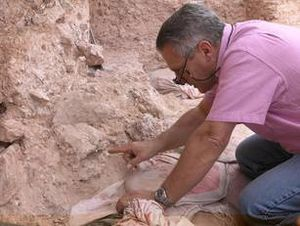 Jebel Irhoud - Jean-Jacques Hublin at Jebel Irhoud (Morocco), pointing to the crushed human skull (Irhoud 10) whose orbits are visible just beyond his finger tip.