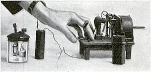 David Edward Hughes - Hughes wireless apparatus, a clockwork driven spark transmitter and battery (right) and a modified version of his carbon block microphone (left) which he used in his 1879 experiments.