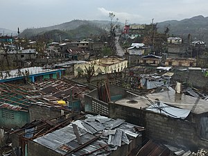 Effects of Hurricane Matthew in Haiti - Poorly constructed homes failed to withstand hurricane-force winds. Countless corrugated tin roofs fell victim to the storm.