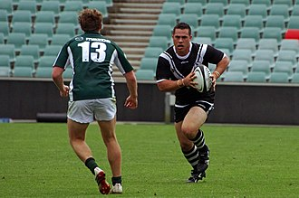 Comparison of rugby league and rugby union - Bronson Harrison of the Western Suburbs Magpies playing in a 2015 hybrid rugby match