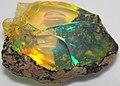 Hydrophane opal (precious opal) immersed in water (Tertiary; Ethiopia) 3 (32332083780).jpg
