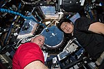 ISS-55 Scott Tingle and Norishige Kanai with SpaceX Dragon CRS-14.jpg