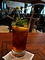Iced Lemon tea with mint leaves in bakery and coffee house.jpg