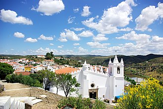 Church of Nossa Senhora da Anunciação - A view of the church on the hilltop with the skyline of Mértola