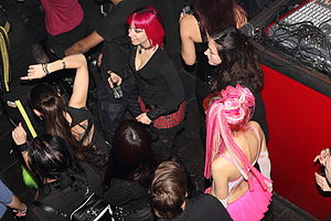 Nightclub - People dance at an industrial music event in a nightclub