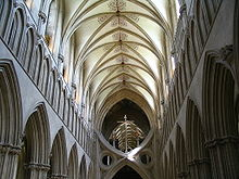 "an interior view of the nave at Wells as described in the text. The nave terminates abruptly in a structure known as ""St Andrew's Cross"" which was inserted to support the tower."