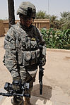 Iraqi soldiers patrol neighborhood east of Baghdad, Iraq DVIDS179795.jpg