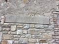 Iscrizione sul portale murato Sebastiano Nanni.jpg