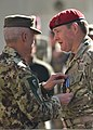 Italian Army Lt. Gen. Giorgio Battisti, left, the International Security Assistance Force (ISAF) chief of staff, presents a British soldier with the NATO-ISAF medal during a ceremony in Kabul, Afghanistan 131117-A-UO630-011.jpg
