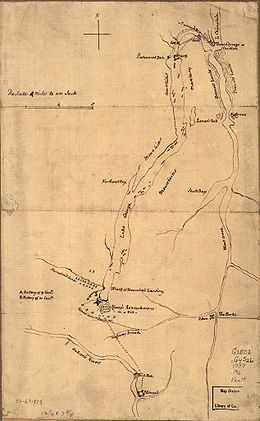 Fort Carillon is at the far northern end of the map, separated from Lake George by a short river with falls.  There is a road or path leading from the fort to the northern end of the lake, with a sawmill at the first crossing.  The map is labelled with mountains to either side of Lake George, which is long and narrow, extending about 3/4 the length of the map.  At its southern end the fort is shown, with the French camp to the northwest, and the camp of Indians and Canadians over the road leading south toward Fort Edward.  The latter is near the bottom of the map, on the Hudson River just below some falls.