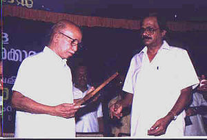 K. Surendran - K. Surendran hands over the fellowship certificate awarded by Kerala Sahitya Akademi to M. T. Vasudevan Nair
