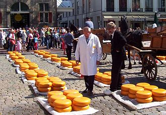 Dutch cheese markets - Wheels of Gouda cheese on sale at Gouda's cheese market
