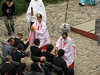 Miko - Miko perform Shinto ceremony near the Kamo River