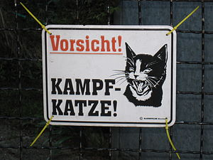 "English: Signs warns of a ""Kampfkatze"""