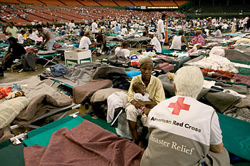American Red Cross personnel attending refugee...