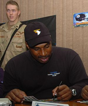 Keith Byars - Byars in Tikrit, Iraq, signing autographs during a February 2006 troop visit.